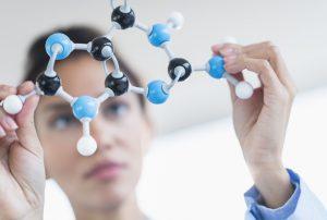 Hispanic scientist examining molecular model